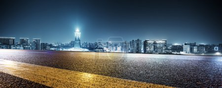 Photo for Modern office buildings in Hangzhou west lake square at night on view from empty street - Royalty Free Image