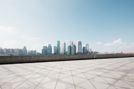 Photo for Modern office buildings in Guangzhou from empty brick floor - Royalty Free Image