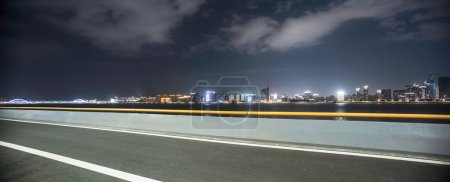 Photo for Illumninated Hangzhou qianjiang new city from empty road - Royalty Free Image