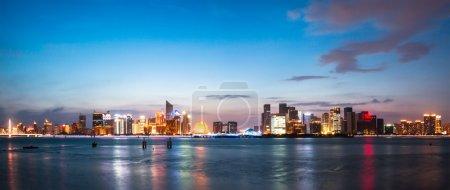 Illumninated Hangzhou qianjiang new city from wate...