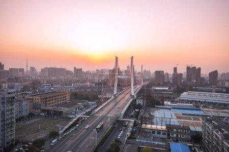 Traffic and skyline near city bridge