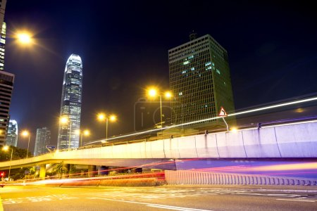 Photo for Traffic light trails at modern city street,hongkong. - Royalty Free Image