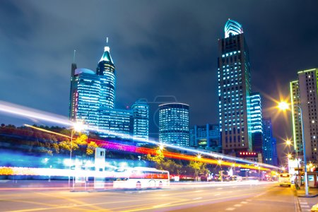 Photo for Traffic trails and office buildings in modern city. - Royalty Free Image