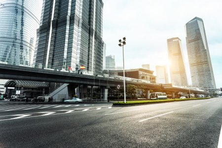 Photo for Skyline, urban road and modern office buildings at sunset - Royalty Free Image