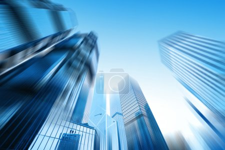 Photo for Low angle view of skyscrapers in blurred motion. - Royalty Free Image