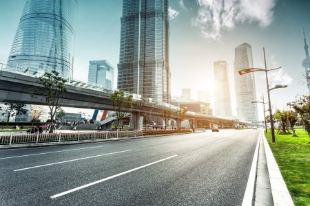 Photo for Urban road and modern city skyline - Royalty Free Image