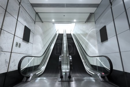 escalator in underground tunnel