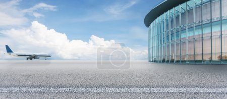 Empty square with airplane and modern building