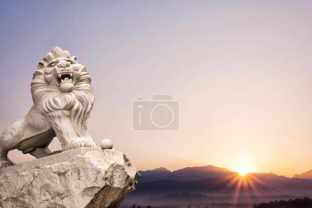 lion statue with landscape at sunrise