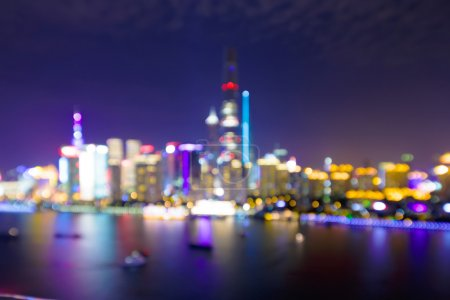 illuminated and defocused skyline and cityscape of Shanghai
