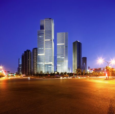 Photo for Asphalt road near skyscrapers of a modern city at night - Royalty Free Image