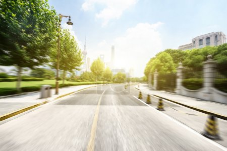 Photo for Empty asphalt road in modern city with green belt - Royalty Free Image