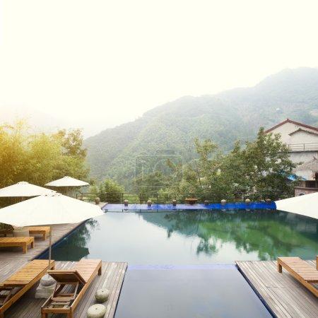 Umbrella chair in hotel pool resort