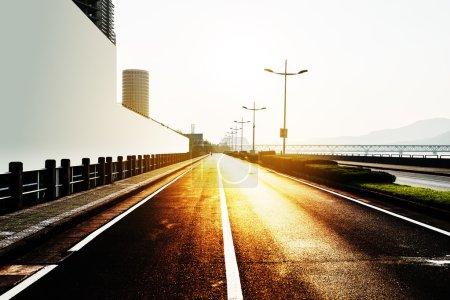 sun skyline and road by billboard