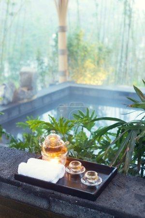 tea set on plate near spa pool