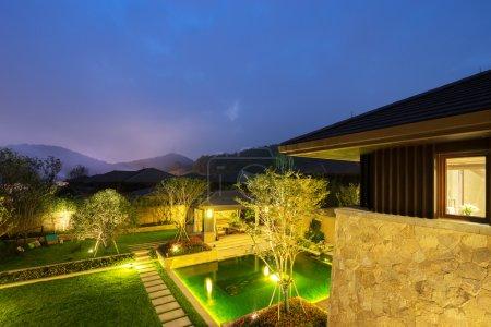 Backyard in modern villa in clear sky at night