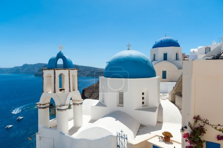 White and blue Santorini - view of caldera with domes
