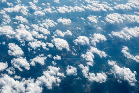 Aerial view of the clouds and land