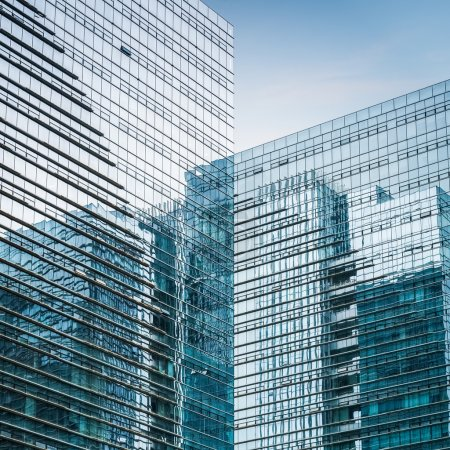 Photo for Modern glass skyscraper closeup , exterior of blue curtain wall with abstract spac - Royalty Free Image