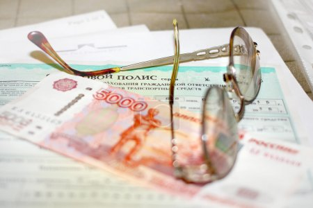 Photo for Russian money, glasses and papers for auto insurance - Royalty Free Image