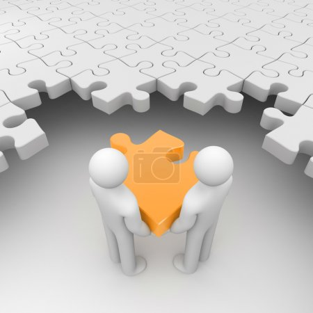 Two persons holding orange puzzle