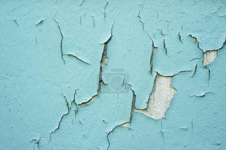 Photo pour Fissuration, épluchage, peinture bleue . - image libre de droit
