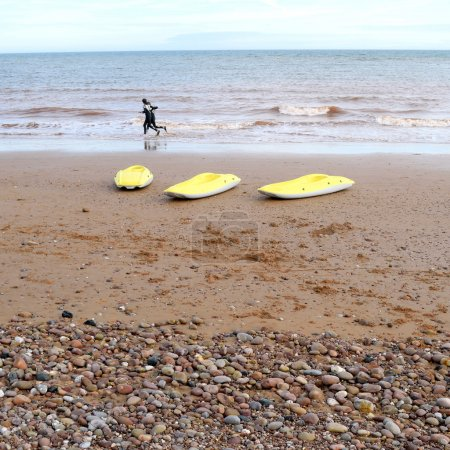 Three yellow kayaks