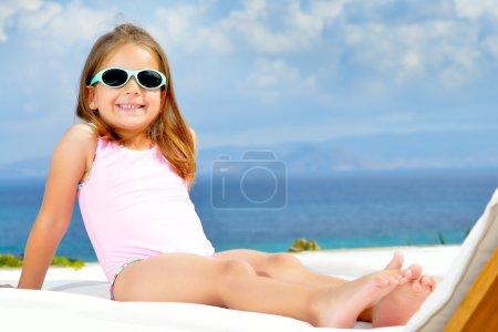 Adorable girl on sunbed