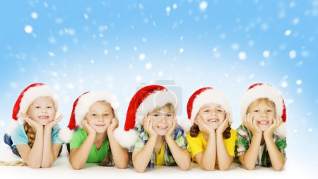 Christmas Children In Santa Helper Hat, Little Kids Boys and Girls Happy Greeting Xmas Holiday