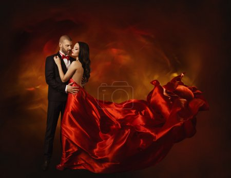 Photo for Elegant Couple Dancing in Love, Woman in Red Clothes and Lover Man in Classic Suit, Long Waving Dress - Royalty Free Image