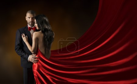 Photo for Couple Beauty Portrait, Man in Suit Woman in Red Dress, Rich Lady in Gown, Waving Silk Fabric, Couple Portrait - Royalty Free Image