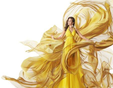 Photo pour Robe de mannequin de mode, Femme en tissu fluide robe, Vêtements flux sur le vent, Blanc jaune - image libre de droit