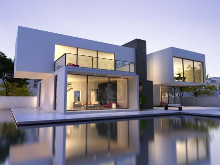 External view of a modern house with pool at dusk...