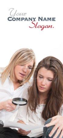 Girls examining document