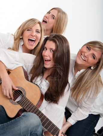 Photo for Young girls singing with guitar - Royalty Free Image