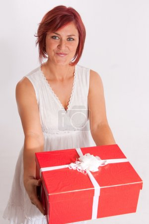 Happy red headed woman with present