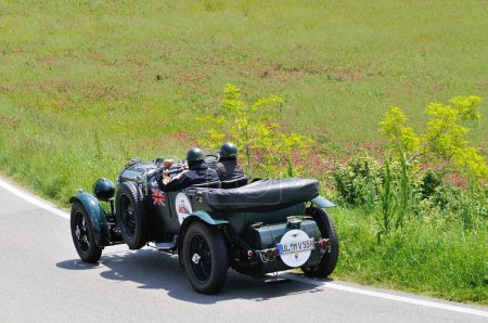 A green Bentley 4.5 Litre Le Mans takes part to the 1000 Miglia classic car race