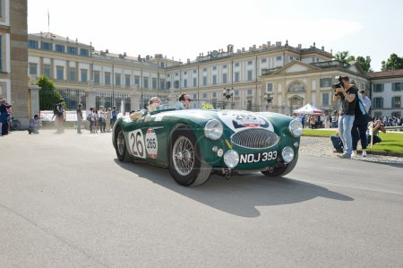 A green Austin Healey 100 S takes part to the 1000 Miglia classic car race