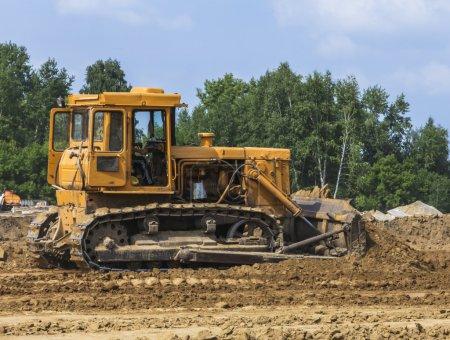 Bulldozer tractor moving soil