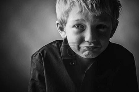 Photo for Sad Young Boy on dark background - Royalty Free Image