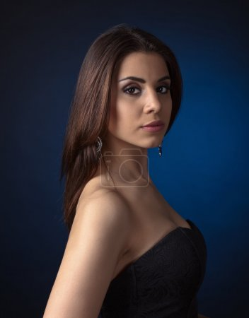 young beautiful woman on dark blue background