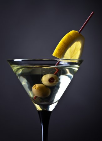 Photo for Glass of martini with lemon and green olives - Royalty Free Image