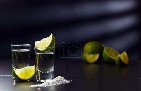 Photo for Tequila , lime and salt on black table - Royalty Free Image