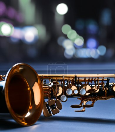 Saxophone before a window in nightclub...