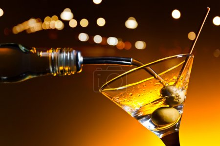 Photo for Dry martini with olives ,focus on a berry - Royalty Free Image