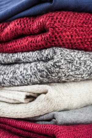 Stack of handmade wool sweaters
