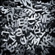 Pile of wooden letters in English and monochrome...