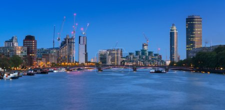 Cityscape of London with reflection in Thames river