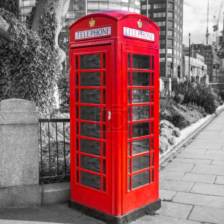 Red telephone booth on the street of London