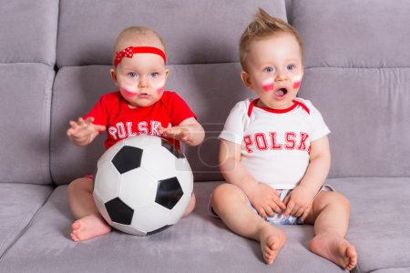 Soccer baby twins fans of Poland team